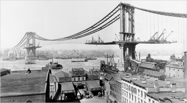 The Manhattan Bridge under construction in 1909, the year it officially opened. But it was not completed until years later.